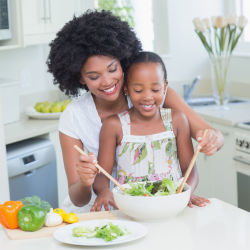 A mother and daughter preparing a healthy meal
