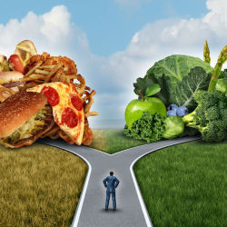 A person choosing between healthy and unhealthy foods