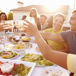 friends cheers at a dinner party