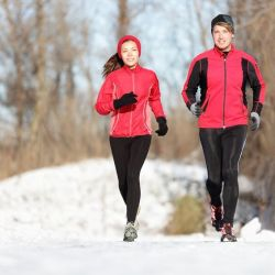 A man and a woman getting exercise in winter weather