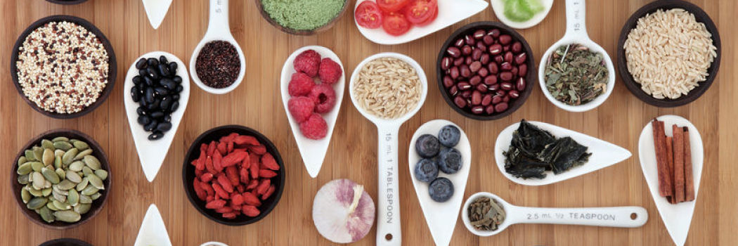 whole food ingredients in measuring cups on a wooden table