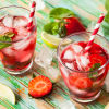 glasses of strawberry and mint infused water on a table