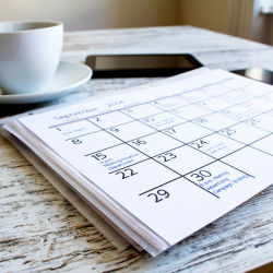 Cup of coffee in front of a calendar
