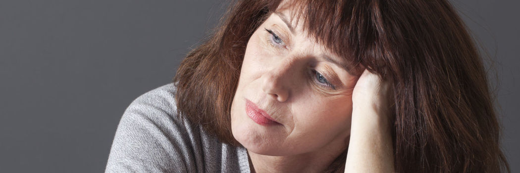 frustrated middle age woman reflecting on her decisions