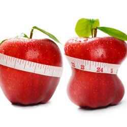 Measuring tape around apples