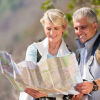 Man and woman looking at a map while they hike