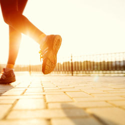 concept of a woman running early in the morning exercising to start the day