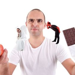 man struggling between eating chocolate and an apple