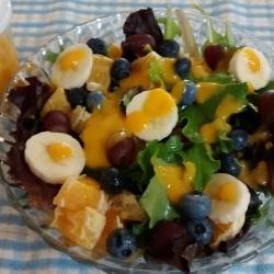 A homemade salad with mango dressing