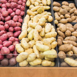 An assortment of different potatoes on sale at the supermarket