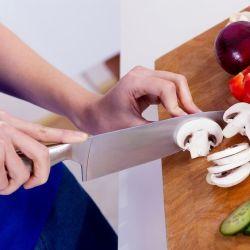 close up of a woman cutting mushrooms