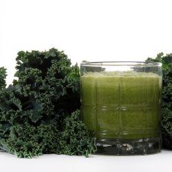 Fresh kale leaves near juiced kale beverage
