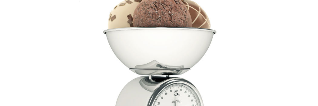 Ice cream being weighed in a food scale
