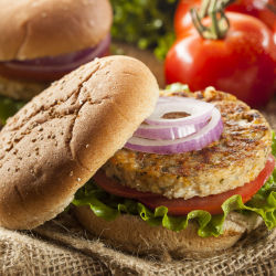 healthy vegetarian black bean burger with lettuce, tomato, and onion