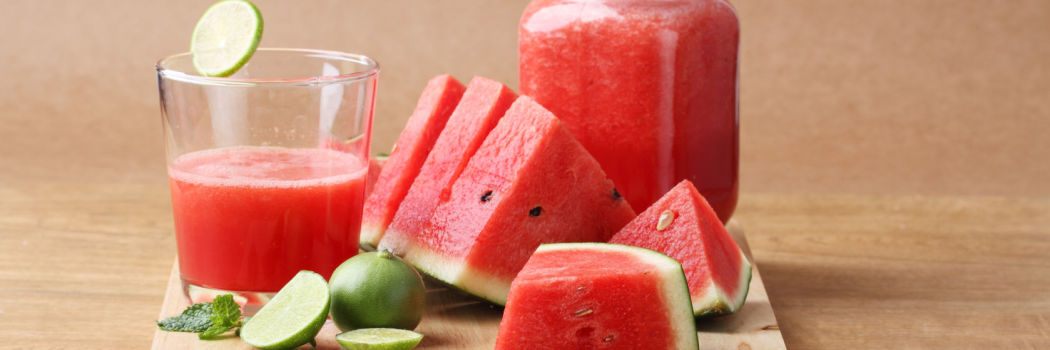 watermelon and lime on a cutting board for a green smoothie