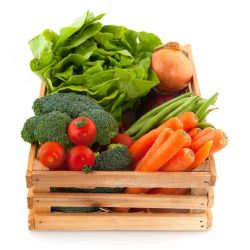 a wooden crate of colorful lettuce, broccoli, tomatoes, onion, and carrots