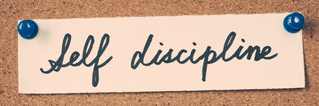 self discipline spelled out in cursive and pinned to a cork board