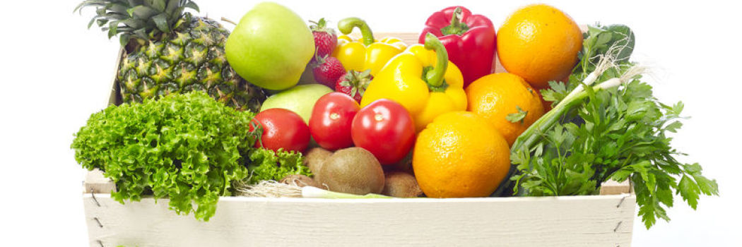 A box filled with delicious greens, fruits, and vegetables