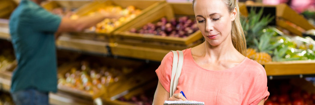 A woman sticking to her healthy grocery list